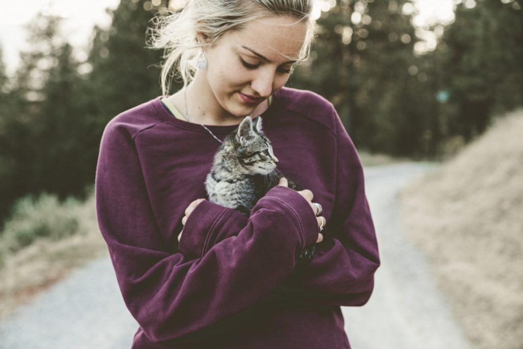 Hugging a Cat Outdoors